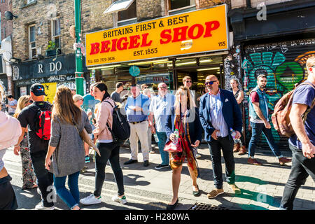 London, United Kingdom - September 11, 2016: Brick Lane street Sunday market. Famous Britains First and Best Beigel - Stock Photo