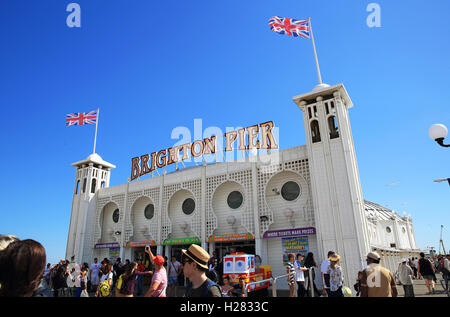 The entrance to the iconic Palace Pier, in Brighton, on a warm, summer's day, in East Sussex, England, UK - Stock Photo