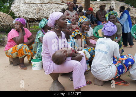 Casamance, Senegal - August 1, 2015:  Women attend the information session. They are the ones in charge of managing - Stock Photo