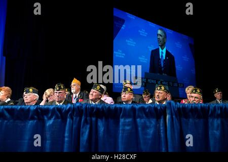 A group of veterans watch as U.S. President Barack Obama delivers a speech during the American Legions 96th National - Stock Photo
