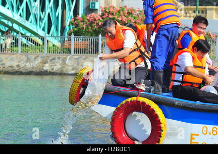 Ho Chi Minh city, Vietnam - April 24, 2015: Fishes are kept in plastic bags preparing to be released in the Saigon river in the