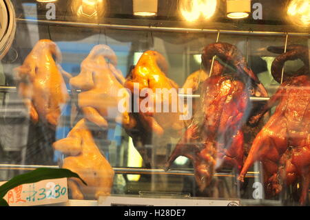 Hong Kong, China - September 10, 2015: Roasted Chinese ducks are displayed in restaurant in Hong Kong - Stock Photo
