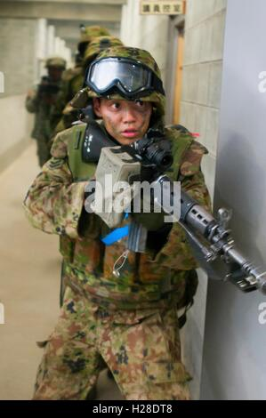 A Japanese Ground Self-Defense Force soldier during a warfare exercise at the Aibano Training Area September 18, - Stock Photo