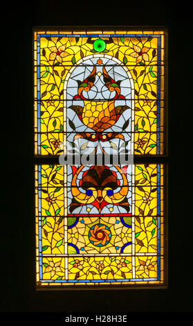 19th century American stylized floral stained glass window. Unknown designer & fabricator. From house in Hyde Park - Stock Photo