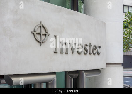 Investec investment bank logo sign outside office in the City of London, UK - Stock Photo