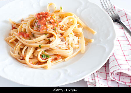 noodles with crab sauce and chopped tomatoes astice bolognese delicious fork italian pasta italian recipe lasagna - Stock Photo
