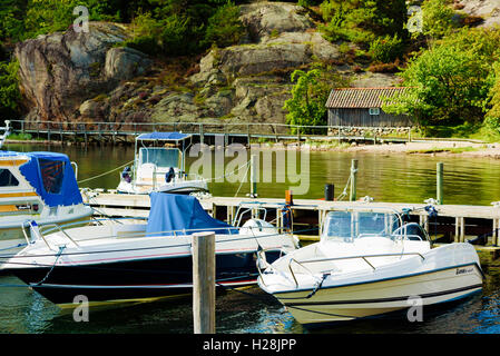 Askeron, Sweden - September 9, 2016: Environmental documentary of small motorboats moored in natural surroundings - Stock Photo