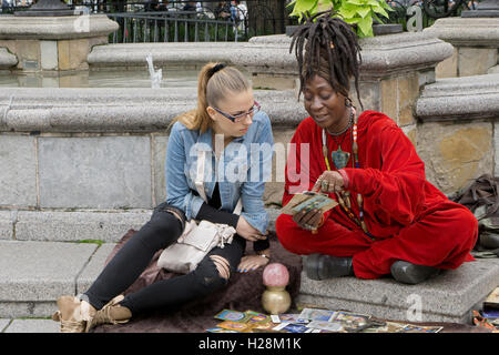 A  psychic tarot card reading in Union Square Park in Manhattan, New York City - Stock Photo