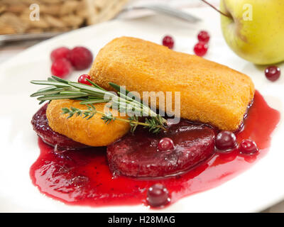 Fried cheese with cranberry sauce  and rosemary leaves - Stock Photo