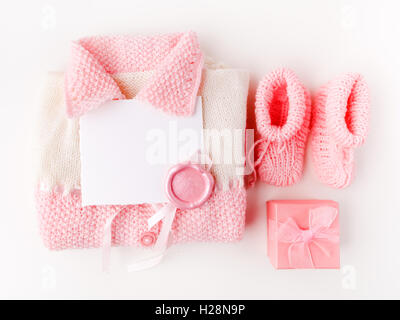 Socks and cloth-pants for baby newborn on white background. Children apparel concept. Flat lay, Top view - Stock Photo