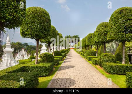The French topiary Garden path & walkway at Suan Nong Nooch or NongNooch Tropical Botanical Garden Resort, Chon - Stock Photo