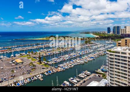 Top view of Ala Wai Boat Harbor and Magic Island in Honolulu, Oahu, Hawaii, USA - Stock Photo