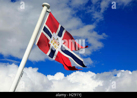 National flag flying on post ship Hurtigruten ferry, Norway looking up from below - Stock Photo