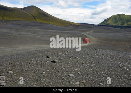 Caravan on dirt road in barren volcanic landscape, F208, Fjallabak National Park, Iceland - Stock Photo