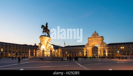 Arco da Vitoria, equestrian statue of King Joseph I at Praça do Comércio, dusk, Lisbon, Portugal - Stock Photo