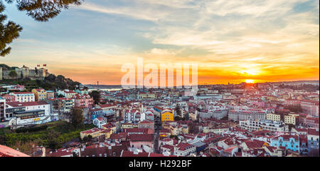 View across Lisbon, São Jorge Castle, sunset, Graça viewpoint, Lisbon, Portugal - Stock Photo