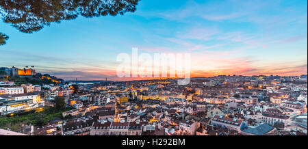 View across Lisbon, São Jorge Castle, sunset, Graça viewpoint, Lisbon, Portugal - Stock Photo