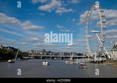The London Eye or Millenium Wheel on the South Bank of the River Thames in London England UK viewed from the river. - Stock Photo