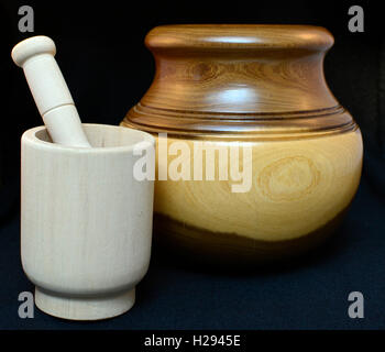 Contrast concept. Wooden pot varnished and unvarnished wooden mortar and pestle. Wooden kitchen utensils. - Stock Photo