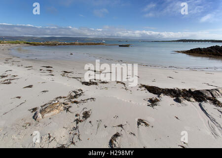 Isle of Gigha, Scotland. Picturesque tranquil view of a sandy beach in Ardminish Bay, on the Isle of Gigha. - Stock Photo