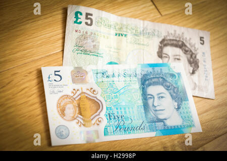 A new and old five pound note - Stock Photo