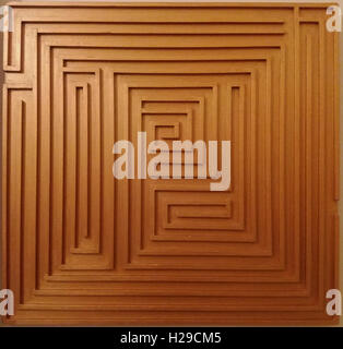 Pictures taken during the construction of handmade wooden labyrinths and mazes decorative panels and some mosaics .
