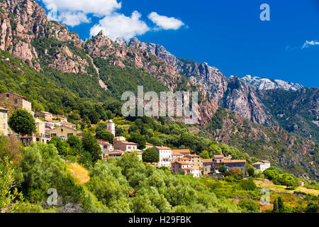 Ota town with the mountains in the background near Evisa and Porto, Corsica, France. - Stock Photo