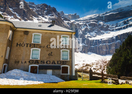 Hotel and snow-covered mountain landscape. - Stock Photo