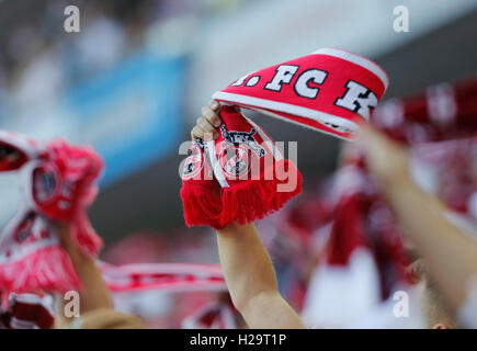 Cologne, Germany 25.09.2016, Bundesliga, matchday 5, 1. FC Koeln - RB Leipzig:  Cologne supporters wave scarfs. - Stock Photo