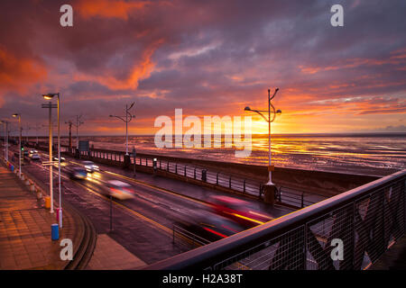 Southport, Merseyside, UK. 26th September, 2016. UK Weather.  A break in the rain clouds at sunset. Southport pier - Stock Photo