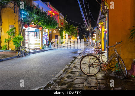 Night view of shopping street in old town of Hoi An, Vietnam - Stock Photo