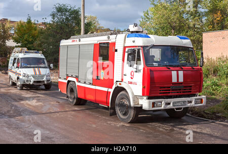 ... Red Fire Truck EMERCOM Of Russia And Rescue Vehicle Parked Up On The  Street In Summer