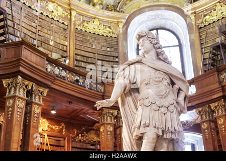 Vienna, Austria - August 14, 2016: Sculpture in The State Hall (Prunksaal), the heart of the Austrian National Library. - Stock Photo