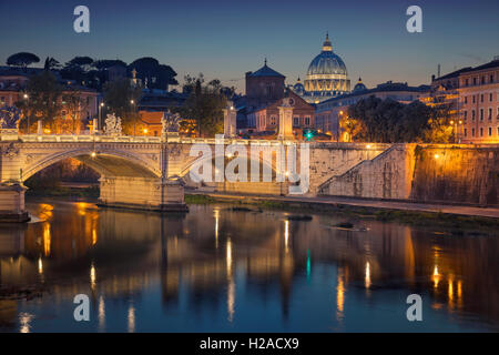 Rome. View of Vittorio Emanuele Bridge and the St. Peter's cathedral in Rome, Italy at night. - Stock Photo
