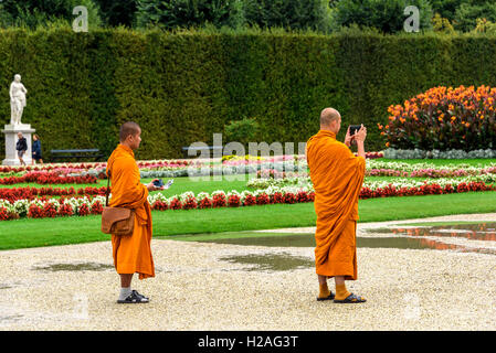Two Buddhist monks visiting Schonbrunn  Palace Vienna. - Stock Photo