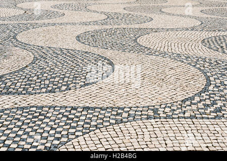 Wavy pattern in pavement, black and white, cobblestones, Belém, Lisbon, Portugal - Stock Photo