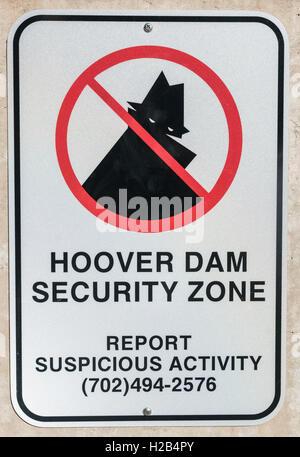 Sign, Hoover Dam security zone, report suspicious activity, Hoover Dam, Las Vegas, Arizona, USA - Stock Photo