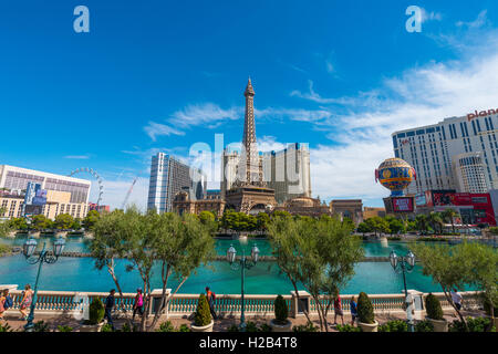 Replica of Eiffel Tower, Paris Hotel and lake in front of Bellagio Hotel, Las Vegas, Nevada, USA - Stock Photo
