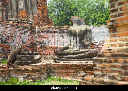 Damaged Buddhas at the  old Siam capital city of Ayuttaya, Thailand - Stock Photo