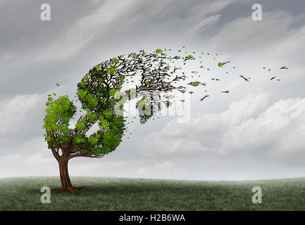 Financial trouble and money adversity or economic crisis concept as a tree being blown by the wind and damaged or - Stock Photo