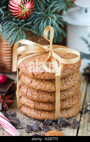 Spiced cookies with almonds. Christmas gifts. Round cookies, tied with ribbon and spruce branch in a basket on the - Stock Photo