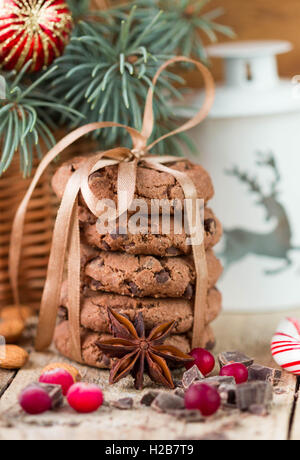 Chocolate chip cookies, cranberry and chocolate. Christmas gifts. Round cookies, tied with ribbon and spruce branch - Stock Photo