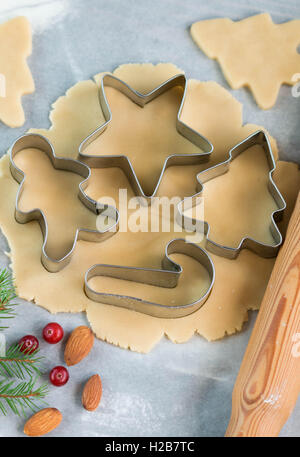 Baking Christmas cookies - dough on the table, cookie cutters and cookies. New year. Christmas - Stock Photo