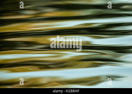 Waves in a river at sunset as another boat went by, in Pantanal area of Brazil. - Stock Photo