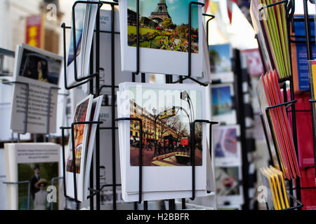 Close up view of French postcards on racks about subway sign on Rue Montorgueil street in Paris. - Stock Photo