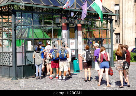 Tourists queuing for the Siklo funicular in Budapest that runs from the top of Castle Hill to the Lanchid - Stock Photo