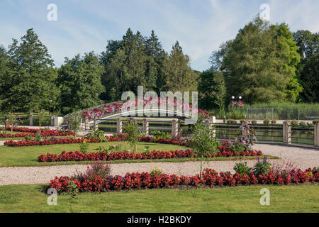 Bridge over lake and casino gardens at Bagnoles de l'Orne in the Orne (61) department of France - Stock Photo