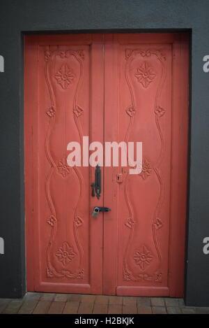 Old burgundy wooden door in Antigua, Guatemala, Central America - Stock Photo