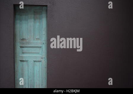 Old turquoise wooden door in Antigua, Guatemala, Central America - Stock Photo