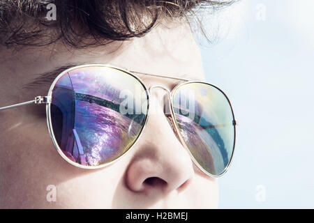 Young caucasian boy with mirroring bridge in sunglasses. Summer theme. Youngster portrait. - Stock Photo